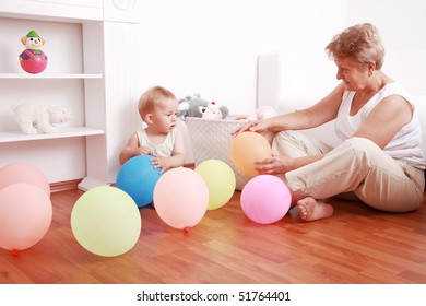 Cute little boy playing with his grandmother