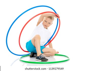 Cute little boy playing with a hoop. Concepts of fitness, children's sports. Isolated on white background.