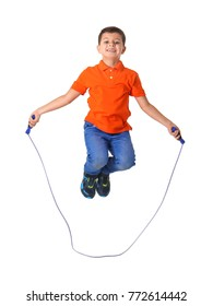 Cute little boy playing with jumping rope on white background