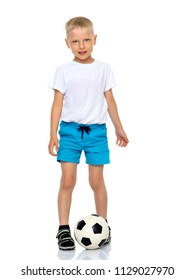 Cute little boy is playing and posing in the studio with a soccer ball. The concept can be used to advertise football clubs, sports outfits, healthy lifestyles. Isolated on white background.