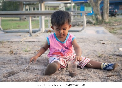 Cute little boy playing sand at the park