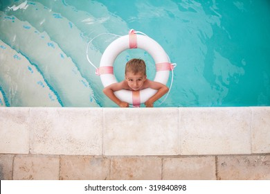 Cute little boy playing in the swimming pool