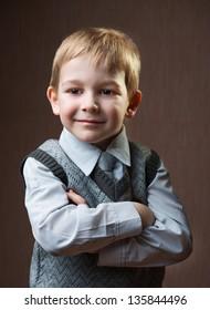 Cute little boy portrait over dark background