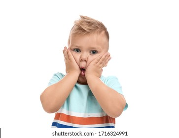 Cute little boy posing on white background