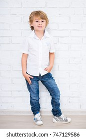 cute little boy posing over white background