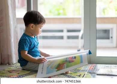 Cute little boy reading a fairy tale at home. Copy space. Learning concept.