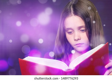 Cute little boy reading magic book on dark color background