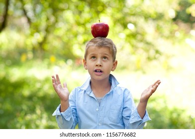 Cute little boy with red apple back to school