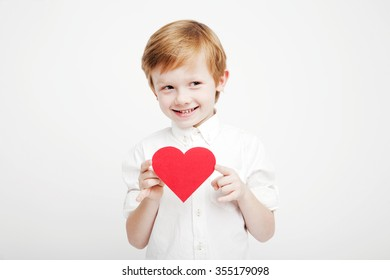 cute little boy with a red heart in the hands
