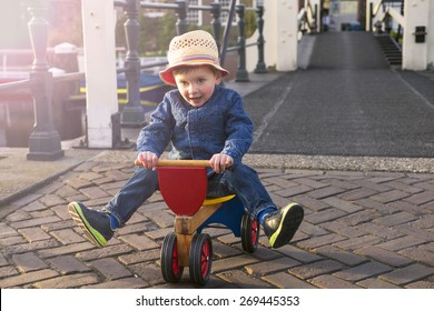 cute little boy riding his tricycle