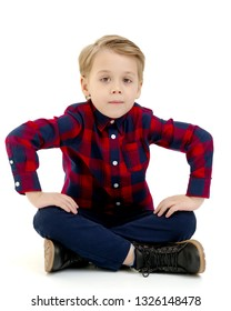 Cute little boy is sitting on the floor on a white background. The concept of a happy childhood, the harmonious development of the child in the family. Isolated.