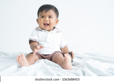 Cute little boy sitting and smile
