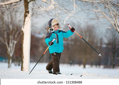 Cute little boy skiing on cross