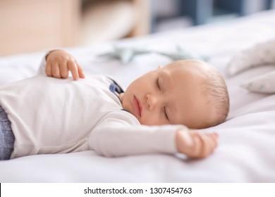 Cute little boy sleeping in bed