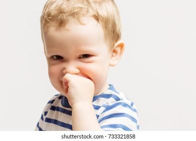 Cute little boy smiles, eyes wide open