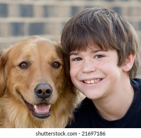 Cute Little Boy Smiling With Dog