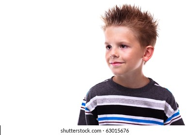 Cute little boy smiling and looking away from the viewer on a white background