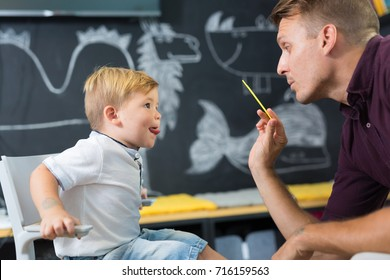 Cute little boy at speech therapist session. Private one on one homeschooling.