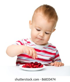 Cute little boy with strawberries, isolated over white