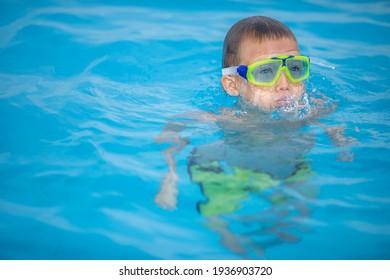 Cute little boy in a swimming pool