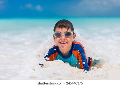 Cute little boy at tropical beach