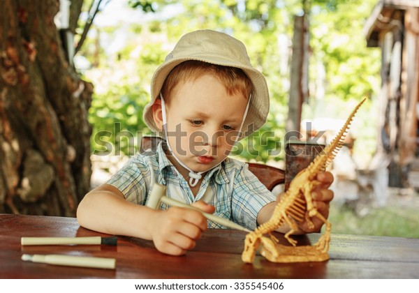 Cute little boy wants to be an archaeologist
