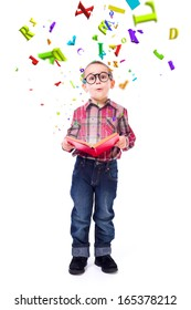Cute little boy wearing glasses, wondering of flying letters from a tale book