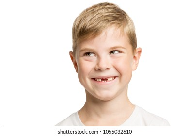 Cute little boy without teeth smiles, isolated on white background, close-up