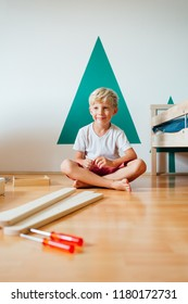 Cute Little Boy Working On Carpentry At Home