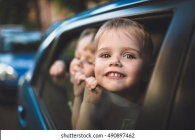 Cute little boys in the car