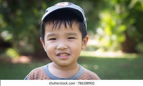 A cute little boy's smile in the garden.
