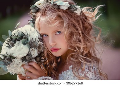 cute little bridesmaid with bunch of flowers wedding concept  cute princess girl Happy little schoolgirl with flowers. Back to school outdoor