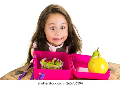 Cute little brunette girl with her healthy lunchbox isolated on white