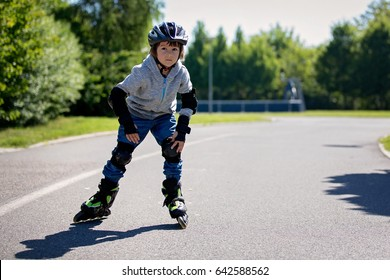 Cute little child, boy,  skating  in the park, springtime