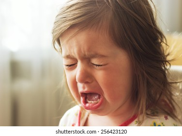 Cute little child is crying