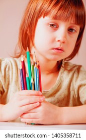 Cute little child girl with colored pencils. Art, creative, talent, education,  happy childhood concept.
