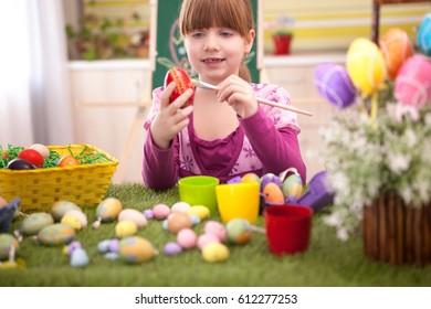Cute little child girl preparing for Easter