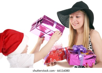 cute little child giving gifts to a beautiful young girl