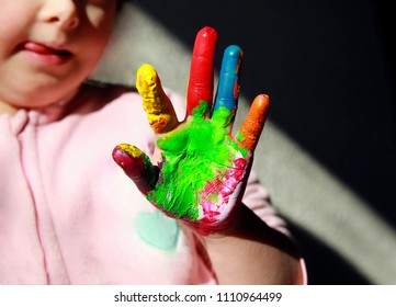 Cute little child with painted hands