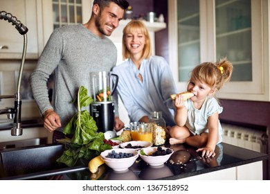 Cute little child with parents eating breakfast on morning