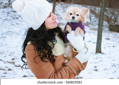 Cute little child playing walking in sunny winter day