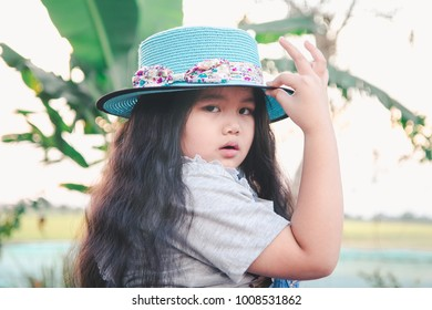 Cute little child posting with hat