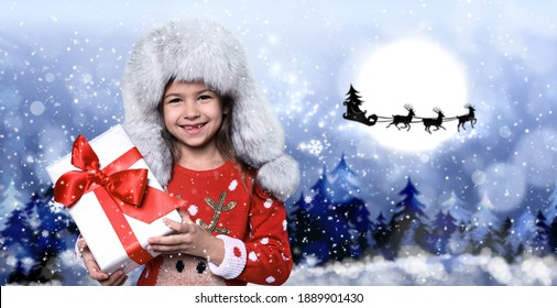 Cute little child and Santa Claus flying in his sleigh against moon sky on background. Christmas celebration