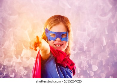 Cute little child is wearing a superhero fancy dress. Kids costume conception.