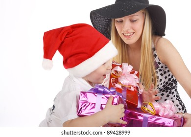cute little child and young pretty beautiful girl with the christmas gifts