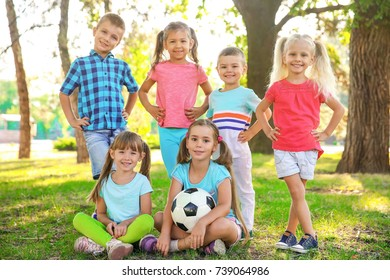 Cute little children with ball in park