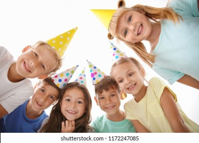 Cute little children in Birthday hats at party, bottom view