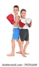 Cute little children in boxing gloves on white background