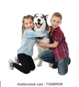 Cute little children with Husky dog on white background