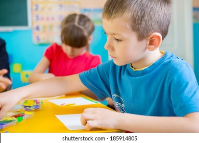 Cute little children on lesson at kindergarten